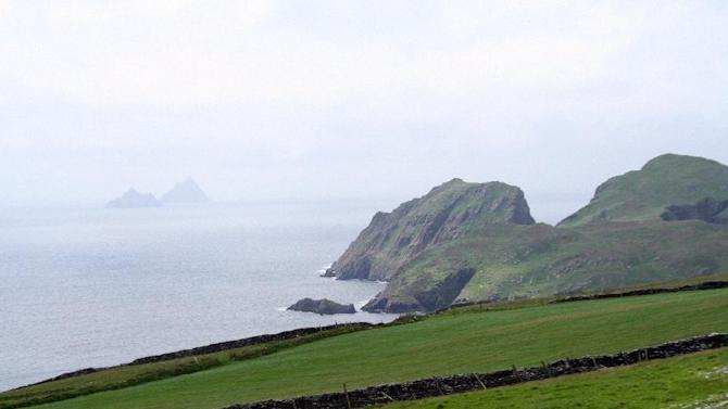 This May 28, 2012 photo shows a view of the Skellig Islands off the coast of the Iveragh Peninsula in County Kerry, Ireland. Ireland is about 300 miles from north to south and a driving trip in the country's western region takes you along hilly, narrow roads with spectacular views ranging from seaside cliffs to verdant farmland.  (AP Photo/Jake Coyle)