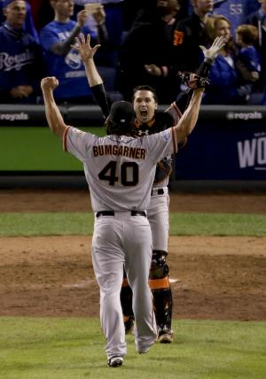 San Francisco Giants starting pitcher Madison Bumgarner, left, and catcher Buster Posey celebrate 3-2 win against the Kansas City Royals in Game 7 of baseball's World Series Wednesday, Oct. 29, 2014, in Kansas City, Mo. (AP Photo/Charlie Riedel)
