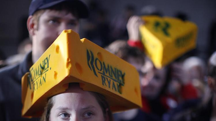 Darla Flemming from Greenfield, Wis., wearing a cheesehead hat waits for Republican presidential candidate, former Massachusetts Gov. Mitt Romney at a campaign stop at the Wisconsin Products Pavilion at State Fair Park in West Allis, Wis., Friday, Nov. 2, 2012. (AP Photo/Charles Dharapak)