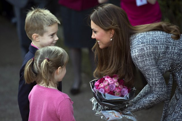 Britain&#39;s Kate, The Duchess of Cambridge receives flowers, as she leaves after a visit to Hope House, in London, Tuesday, Feb. 19, 2013. As patron of Action on Addiction, the Duchess was visiting Hope House, a safe, secure place for women to recover from substance dependence. (AP Photo/Matt Dunham)
