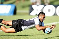 Fiji&#39;s winger Metuisela Talebula dives over for as try against Scotland during their rugby union match in Lautoka, on June 16. Talebula said on Friday he has signed a contract with French Top 14 club Bordeaux-Begles