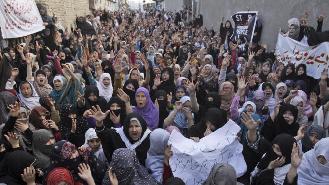 Pakistani Shiite Muslim women chant slogans during a protest to condemn Saturday's bombing, in Quetta, Pakistan, Sunday, Feb. 17, 2013. Angry residents on Sunday demanded government protection from an onslaught of attacks against Shiite Muslims, a day after scores of people were killed in a massive bombing that a local official said was a sign that security agencies were too scared to do their jobs. (AP Photo/Arshad Butt)