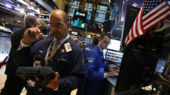 Traders work on the floor of the New York Stock Exchange (NYSE) just after the opening bell, October 10, 2013. REUTERS/Mike Segar