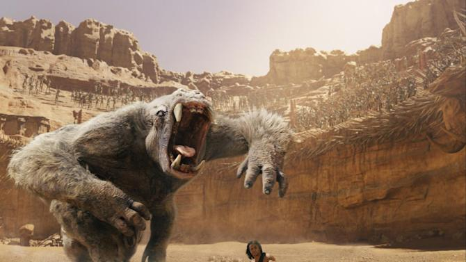 """In this film image released by Disney, Taylor Kitsch is shown in a scene from """"John Carter."""" The Walt Disney Co. said Monday that it expects to book a loss of $200 million on the movie in the quarter through March. That's among Hollywood's biggest money-losers ever. (AP Photo/Disney)"""