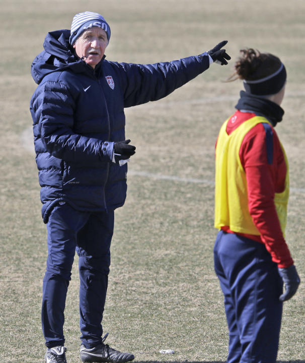 In this photo taken on Tuesday, Jan. 28, 2014, U.S. women's soccer head coach Tom Sermanni, left, speaks to Carli Lloyd during team practice in Frisco, Texas. Sermanni found out what a unique job
