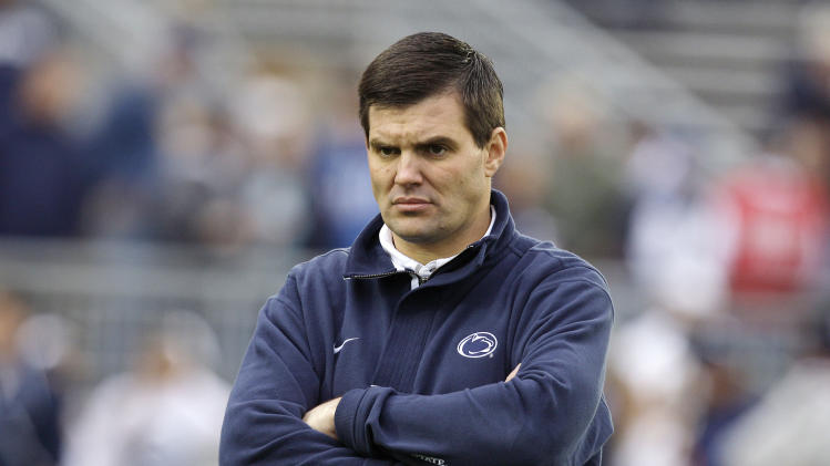 FILE - In this Saturday, Oct. 10, 2009, file photo, Penn State assistant coach Jay Paterno looks on as his team warms up for their  NCAA college football game against Eastern Illinois in State College, Pa. When Penn State opens its football season on Saturday, Sept. 1, 2012, for the first time since 1965, no one with the last name of Paterno will be on the sidelines. Joe died of cancer in January 2012, just months after losing his job in the wake of the Jerry Sandusky sex abuse scandal. Jay has been traveling and writing columns at a time when he's usually used to getting ready for the season opener. (AP Photo/Carolyn Kaster, File)