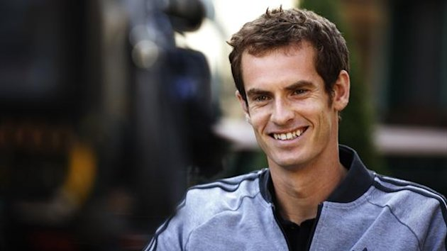 Tennis player Andy Murray of Britain is interviewed for a breakfast television program the morning after winning the men's singles title at the Wimbledon Tennis Championships, Wimbledon, southwest London July 8, 2013. (Reuters)