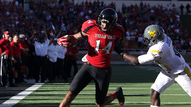 Texas Tech's Darrin Moore scores a touchdown past West Virginia's Karl Joseph during their NCAA college football game in Lubbock, Texas, Saturday, Oct. 13, 2012. (AP Photo/Lubbock Avalanche-Journal, Scott MacWatters) LOCAL TV OUT