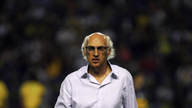 Bianchi, head coach of Argentina's Boca Juniors, arrives on the field before their Copa Libertadores soccer match against Mexico's Toluca in Buenos Aires