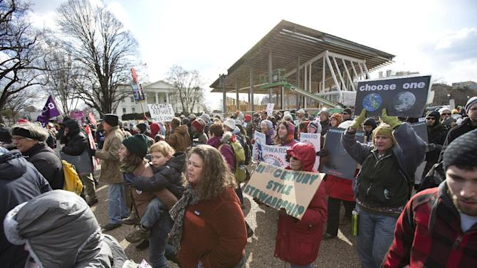 """Protestors march in front of the White House in Washington during a rally calling on President Barack Obama to reject the Keystone XL oil pipeline from Canada, as well as act to limit carbon pollution from power plants and """"move beyond"""" coal and natural gas, Sunday, Feb. 17, 2013.  (AP Photo/Manuel Balce Ceneta)"""