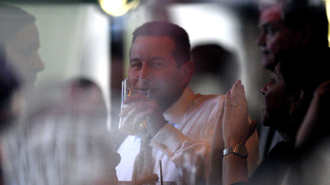 Casey Anthony lead defense attorney Jose Baez, center, enjoys a drink with other members of his defense team and staff while celebrating at a restaurant across the street from the Orange County Courthouse after the not-guilty verdict was announced in Orlando, Fla., Tuesday, July 5, 2011.(AP Photo/Phelan M. Ebenhack)