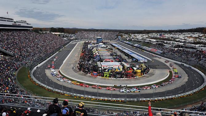 Fans cheer at the start of the NASCAR Sprint Cup Series auto race at Martinsville Speedway, Sunday, Oct. 28, 2012, in Martinsville, Va. (AP Photo/Don Petersen)
