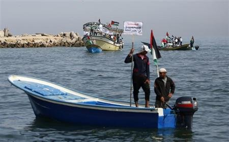 Palestinian fishermen riding fishing boats take part in a protest calling for an increased fishing zone, at the seaport of Gaza City