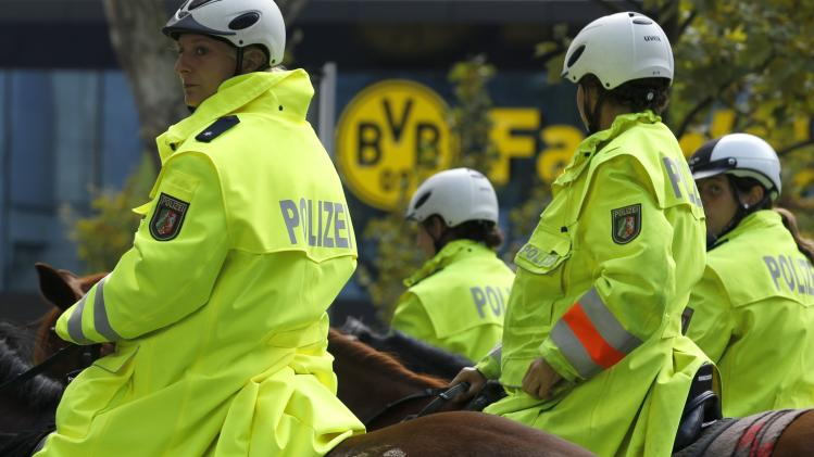 Mounted police officers watch the crowd before the German first division Bundesliga soccer match between Borussia Dortmund's and Bayer Leverkusen in Dortmund