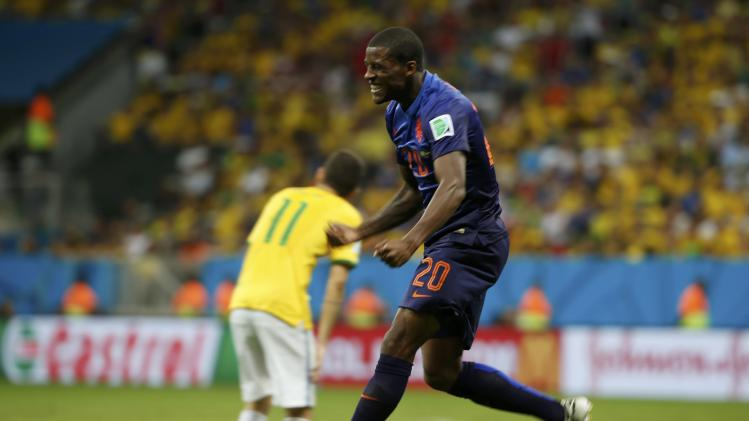 Georginio Wijnaldum of the Netherlands celebrates after scoring a goal during the 2014 World Cup third-place playoff between Brazil and the Netherlands at the Brasilia national stadium