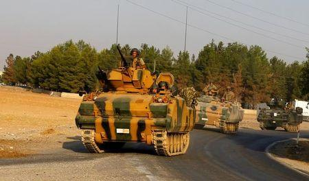 Turkish armoured personnel carriers drive towards the border in Karkamis on the Turkish-Syrian border