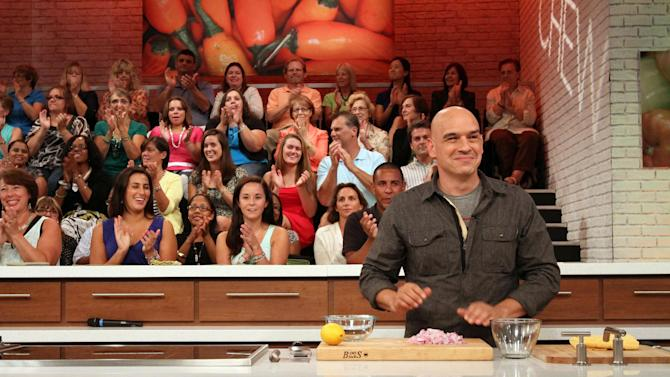 "This Friday, Aug. 26, 2011 photo shows audience members as they applaud while Iron Chef Michael Symon, co-host of ABC's ""The Chew"", foreground, starts a segment during a rehearsal for the show in New York. Can some of food and style TV's biggest stars help ABC soap fans get over cancellation of their favorite stories? The network's counting on it for ""The Chew.""      (AP Photo/Tina Fineberg)"