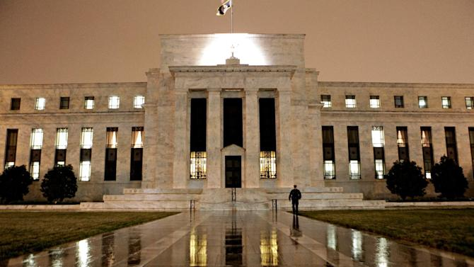 """FILE- This March 27, 2009, file photo, shows the Federal Reserve Building on Constitution Avenue in Washington. With an eye on the """"fiscal cliff,"""" the Federal Reserve is expected to announce a new bond-buying plan to support the U.S. economy on Tuesday, Dec. 11, 2012. (AP Photo/J. Scott Applewhite, File)"""