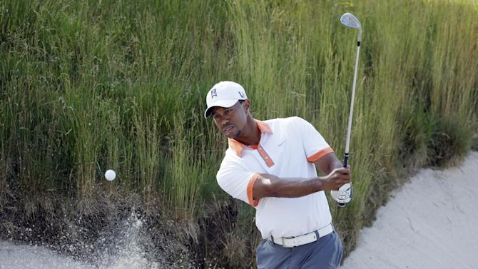 Tiger Woods hits out of a bunker on the 17th hole during practice for the U.S. Open golf tournament at Merion Golf Club, Wednesday, June 12, 2013, in Ardmore, Pa. (AP Photo/Charlie Riedel)