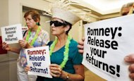 &lt;p&gt;Members of MoveOn.org protest on July 13, at Mitt Romney&#39;s campaign office in Arlington, Virginia. Romney angrily blunted &quot;false&quot; attacks about his time at Bain Capital but did not cede to demands to release more tax returns that have dogged his White House bid&lt;/p&gt;