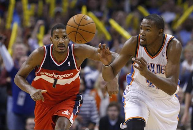 Washington Wizards forward Trevor Ariza (1)  and Oklahoma City Thunder forward Kevin Durant (35) chase a loose ball after Durant blocked a shot by Ariza in overtime  of an NBA basketball game in Oklah
