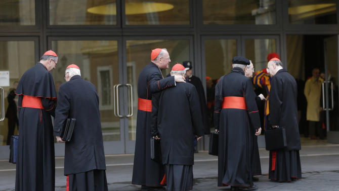 Cardinals, including U.S. Roger Mahony, left, and Timothy Dolan, third from left, arrive for a meeting at the Vatican, Monday March 11, 2013. Cardinals have gathered for their final day of talks before the conclave to elect the next pope amid debate over whether the Catholic Church needs a manager pope to clean up the Vatican's messy bureaucracy or a pastoral pope who can inspire the faithful and make Catholicism relevant again. (AP Photo/Alessandra Tarantino)