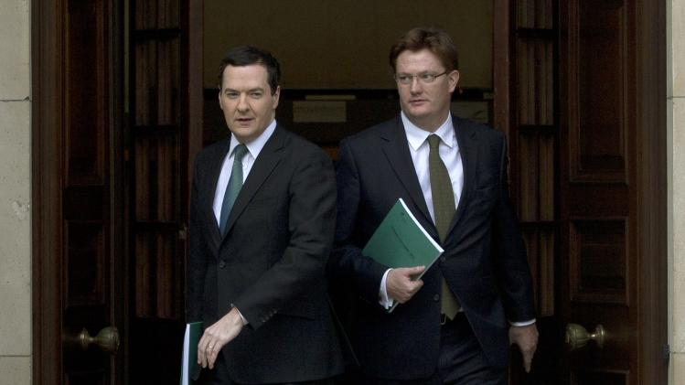 Britain's Chancellor of the Exchequer George Osborne, and the Chief Secretary to the Treasury Danny Alexander leave the Treasury to present the autumn statement at parliament in London