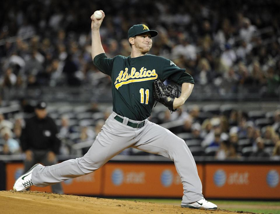 Oakland Athletics starting pitcher Jarrod Parker throws to a New York Yankees batter during the first inning of a baseball game Friday, Sept. 21, 2012, at Yankee Stadium in New York. (AP Photo/Kathy Kmonicek)