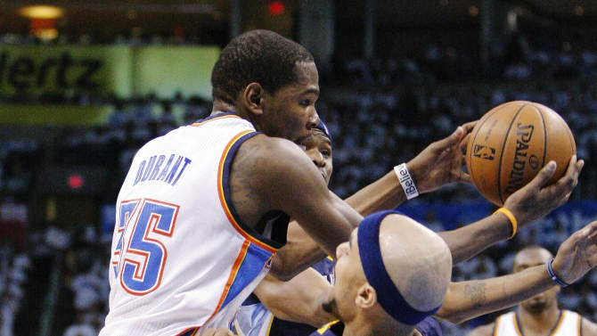 Oklahoma City Thunder forward Kevin Durant (35) drives to the basket as Memphis Grizzlies Jerryd Bayless defends during the first half of Game 5 of an NBA basketball playoffs Western Conference semifinal, in Oklahoma City, Wednesday, May 15, 2013. (AP Photo/Alonzo Adams)