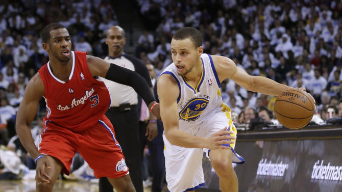Golden State Warriors' Stephen Curry (30) dribbles past Los Angeles Clippers' Chris Paul (3) during the second half of an NBA basketball game in Oakland, Calif., Wednesday, Jan. 2, 2013. Golden State won 115-94. (AP Photo/Marcio Jose Sanchez)