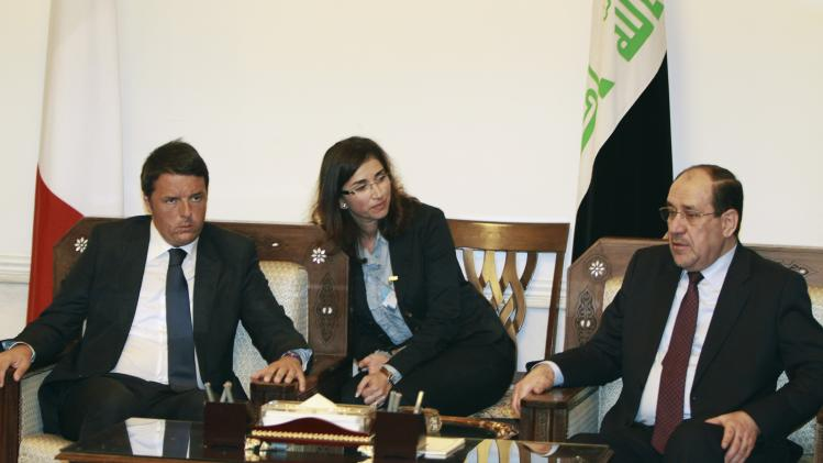 Iraq's former Maliki speaks with Italy's Prime Minister Matteo Renzi during their meeting in Baghdad