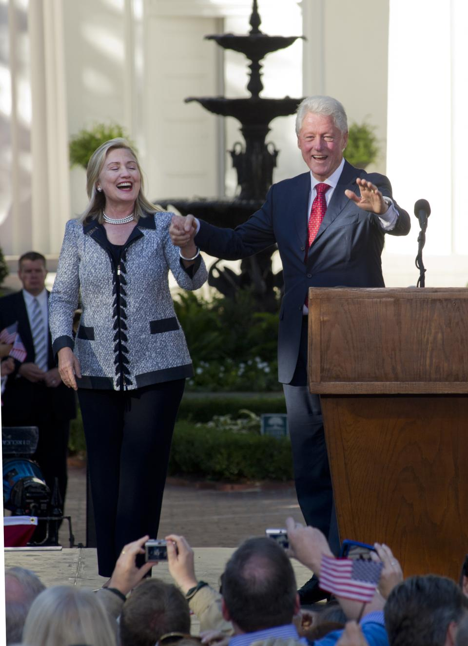 Former President Bill Clinton, right, and U.S. Secretary of State Hillary Rodham Clinton, left, arrive Saturday Oct. 1, 2011 in Little Rock, Ark. at a celebration of the 20th anniversary of former President Clinton's announcement that he would run for President. (AP Photo/Brian Chilson)