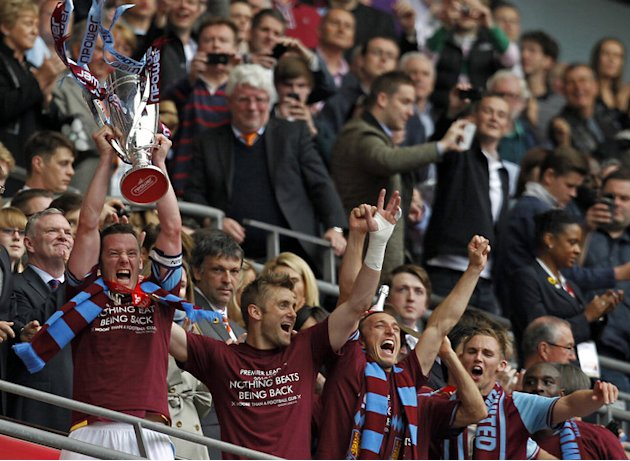 West Ham United's Captain Kevin Nolan (L) Lifts The Trophy   NOT FOR MARKETING OR ADVERTISING USE/RESTRICTED TO AFP/Getty Images