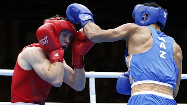 Britain's Freddie Evans (L) fights Kazakhstan's Serik Sapiyev during their Men's Welter (69kg) gold medal boxing match at the London Olympics