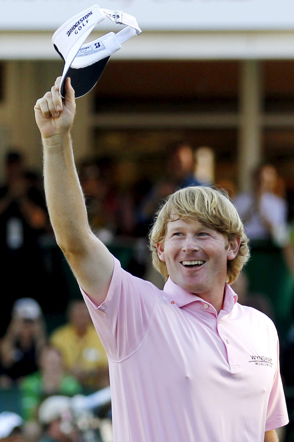 Brandt Snedeker waves to the crowd after winning the Tour Championship golf tournament and the FedEx Cup, Sunday, Sept. 23, 2012, in Atlanta. (AP Photo/John Bazemore)