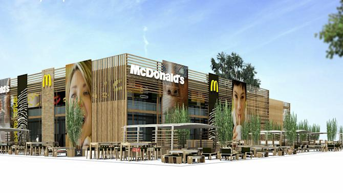 """This undated computer generated image taken from McDonald's website shows the exterior of the London 2012 Olympics-McDonald's Central Restaurant in London.  British doctors have slammed the sponsorship of the London Olympics by companies like McDonalds, saying it sends the wrong message amid the country's ballooning obesity crisis. Big Macs, fries and milkshakes will be part of McDonald's exclusive """"meal brand"""" of the Olympics and the fast-food giant will soon be opening its largest franchise in the world, a two-storey cathedral-like restaurant that seats 1,500 customers, at London's Olympic Park. (AP Photo/Website McDonald's London 2012 Olympic Summer Games)"""