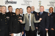 Actor Robert Downey Jr., center, poses with members of the U.S. Military and New York Fire Department before the premiere of &quot;The Avengers&quot; during the 2012 Tribeca Film Festival on Saturday, April 28, 2012 in New York. (AP Photo/Evan Agostini)