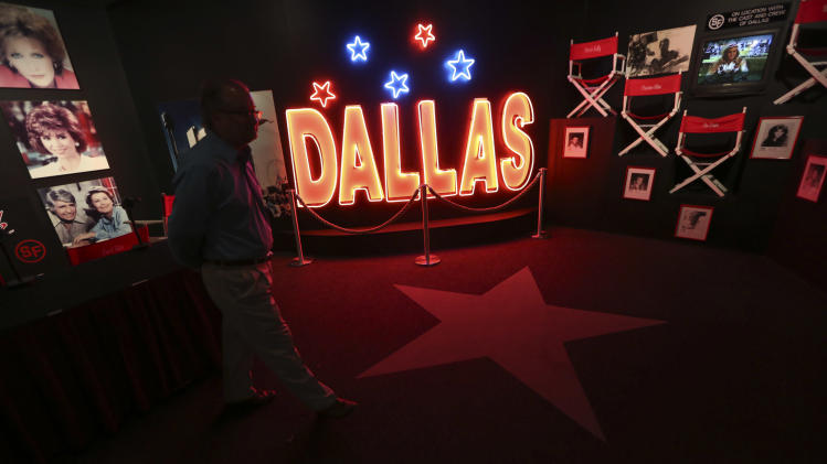 "In this photo made Tuesday, Nov. 13, 2012, a tourist looks at the Dallas TV show museum at Southfork Ranch in Parker, Texas. Tourists have been flocking to Southfork Ranch since the early years of the classic series, which ran from 1978 to 1991. And a new ""Dallas"" starting its second season on TNT on Monday and the recent death of the show's star, Larry Hagman, who legendarily played conniving Texas oilman J.R. Ewing, have also spurred fans to visit. (AP Photo/LM Otero)"