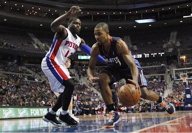 Charlotte Bobcats' Ramon Sessions, right, drives on Detroit Pistons Will Bynum during the first half of an NBA basketball game in Auburn Hills, Mich., Friday, Dec. 20, 2013