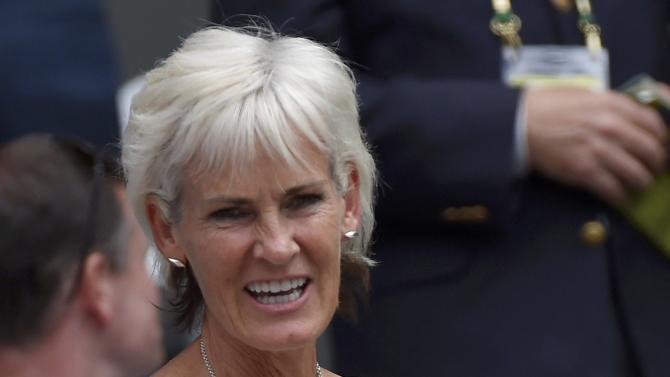 Judy Murray, mother of Andy Murray of Britain arrives to watch his match against Ivo Karlovic of Croatia at the Wimbledon Tennis Championships in London