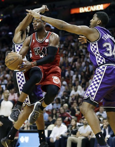 Heat win 12th straight, outlast Kings in 2OT