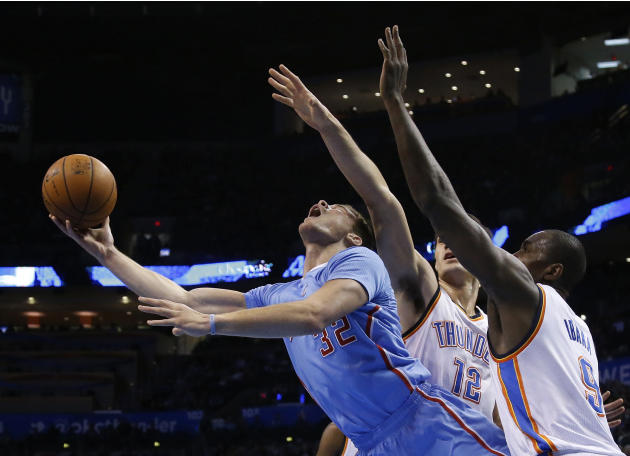 Los Angeles Clippers forward Blake Griffin (32) drives between Oklahoma City Thunder center Steven Adams (12) and forward Serge Ibaka (9) in the first quarter of an NBA basketball game, Sunday, Feb. 2