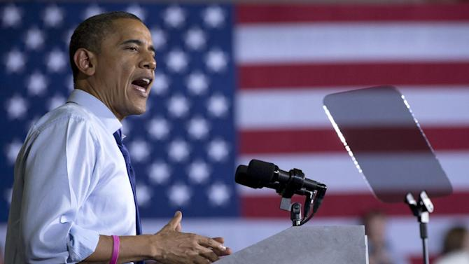 President Barack Obama speaks at a campaign event at Cornell College, Wednesday, Oct. 17, 2012, in Mt. Vernon, Iowa. The president sports a pink bracelet in honor of October being breast cancer awareness month.  (AP Photo/Carolyn Kaster)
