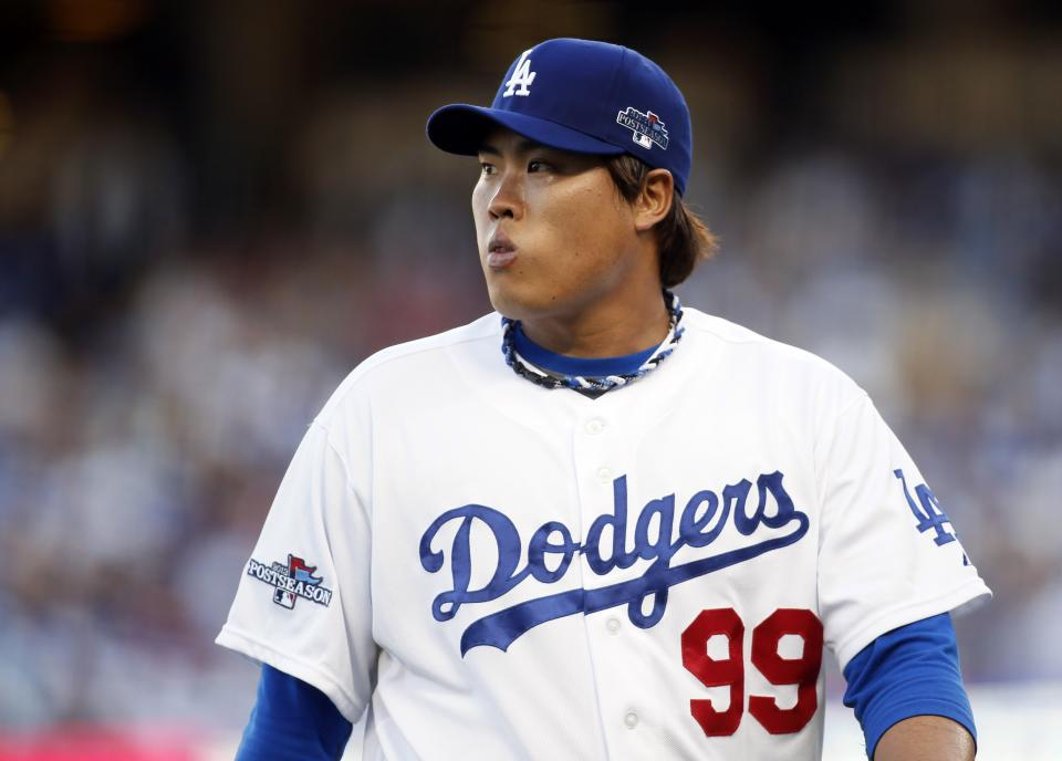 Los Angeles Dodgers starting pitcher Hyun-Jin Ryu pauses on the mound during the first inning of Game 3 of the National League division baseball series against the Atlanta Braves, Sunday, Oct. 6, 2013, in Los Angeles. (AP Photo/Danny Moloshok)