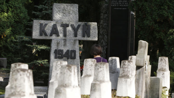 In this photo taken Monday, Sept. 15, 2014, monuments to Polish victims of Stalin stand as a reminder of one of the worst Polish tragedies at Moscow's hands in Warsaw, Poland. The Soviets killed 22,000 Polish officers in 1940 in an attempt to wipe out a swath of the Polish elite. On Wednesday Poles commemorate the 75th anniversary of the Soviet invasion of Poland at the start of the war. The anniversary comes as some Poles are again fearful of Russia due to its aggression in Ukraine.(AP Photo/Czarek Sokolowski)