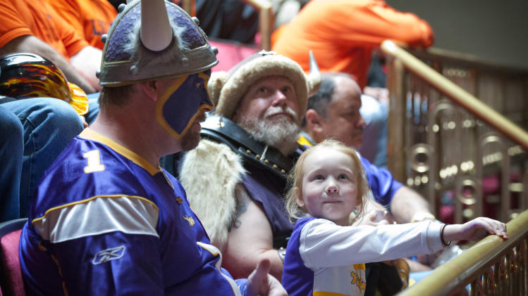 "Minnesota Vikings fan Hannah Walsh, 5, sits between ""Skolt,"" left, also known as Scott Asplund, and Greg Hanson, who goes by Sir Odin, as the state Senate discussed the Vikings stadium bill Tuesday, May 8, 2012, in St. Paul, Minn. (AP Photo/Star Tribune, Glen Stubbe) ST. PAUL OUT  MINNEAPOLIS-AREA TV OUT   MAGS OUT"