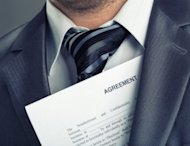 closeup of businessman with a legal contract
