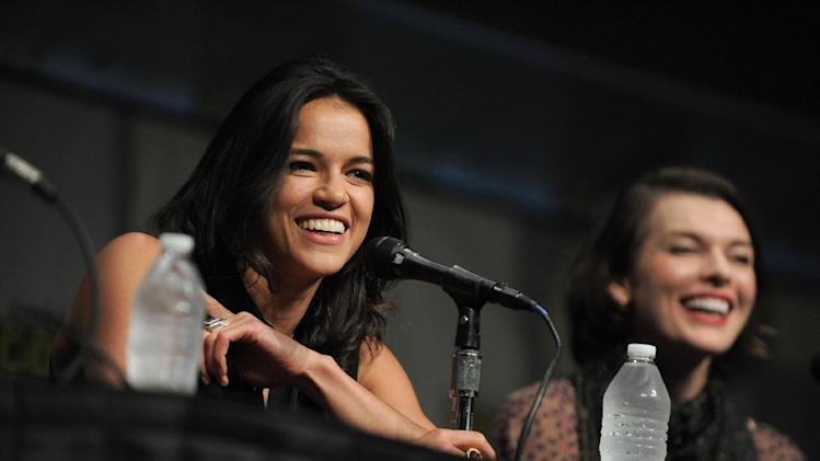"CORRECTS DATE TO FRIDAY JULY 13 - Michelle Rodriguez and Milla Jovovich attend the ""Resident Evil: Retribution"" panel at Comic-Con on Friday, July 13, 2012 in San Diego, Calif. (Photo by Jordan Straus/Invision/AP)"
