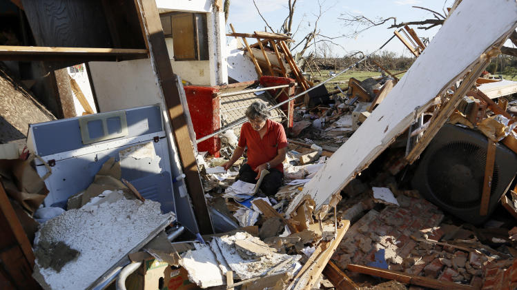 Charles Maloney tries to salvage papers from his tornado-destroyed home on Heather Lane in Moore