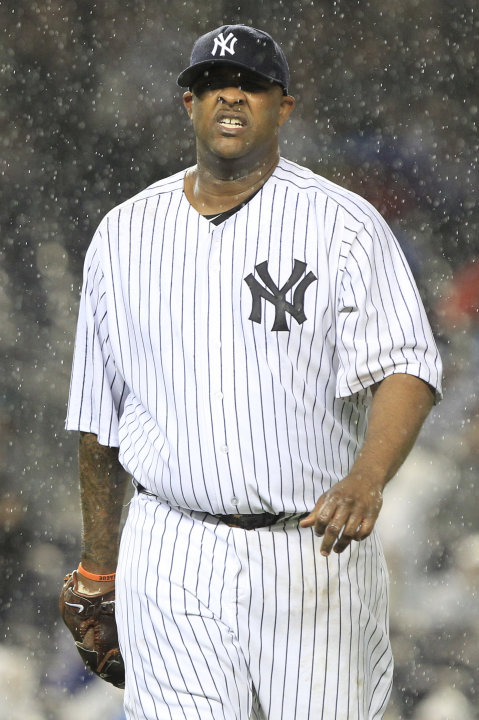 New York Yankees starting pitcher CC Sabathia leaves the field during the second inning against the Detroit Tigers during Game 1 of baseball's American League division series Friday, Sept. 30, 2011, a